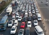 资料图:春运期间,各地高速公路迎来大批车流。 <a target='_blank' href='http://www.chinanews.com/'><p align=