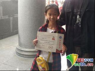 10岁女孩考入大专引议 其父称没舆论纷争反而不正常