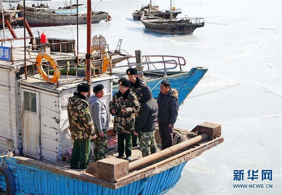 (社会)(3)踏冰巡防保平安