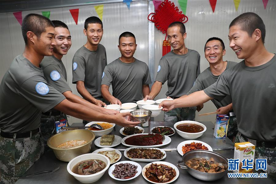 (国际·图文互动)(1)拳拳赤子心 悠悠蓝盔情——记中国赴苏丹达尔富尔维和部队度中秋和国庆佳节