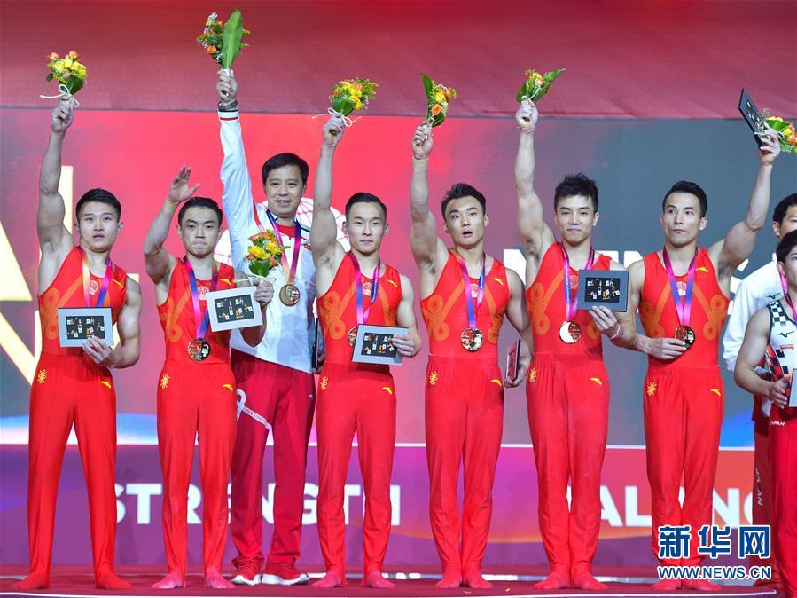 (体育)(1)体操——世锦赛:中国队男子团体夺冠