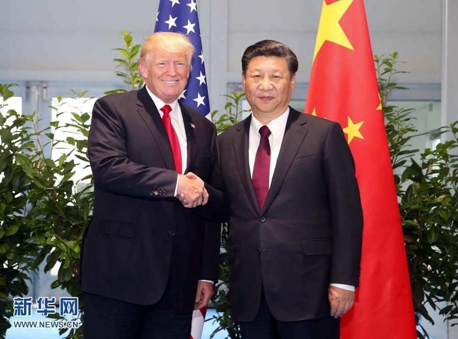 7月8日,国家主席习近平在二十国集团领导人汉堡峰会闭幕后会见美国总统特朗普,就中美关系及共同关心的重大国际和地区问题深入交换意见。新华社记者 姚大伟 摄