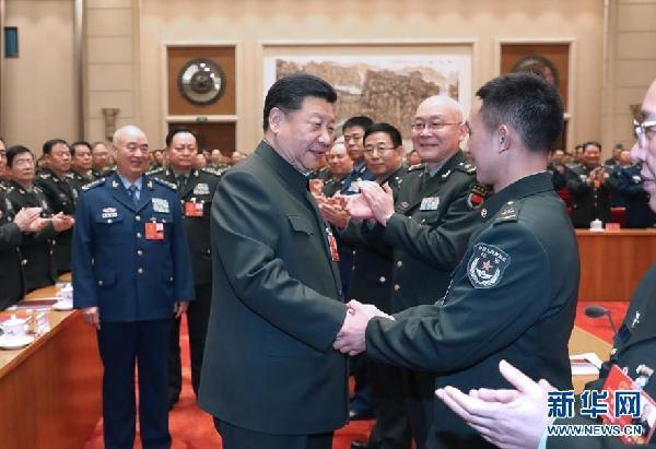 3月12日上午,中共中央总书记、国家主席、中央军委主席习近平出席十三届全国人大一次会议解放军和武警部队代表团全体会议。
