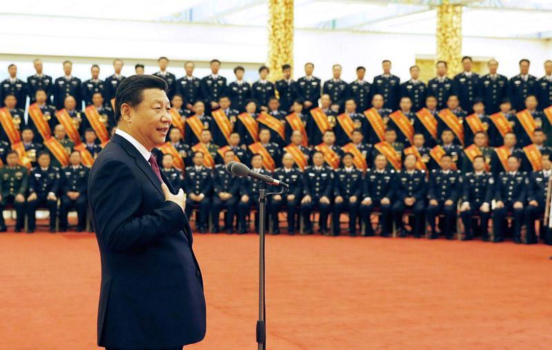 2014年10月28日,习近平在北京人民大会堂会见全国公安机关爱民模范集体代表和爱民模范。