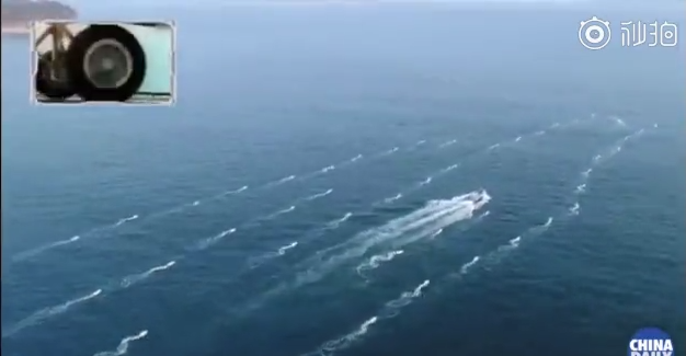 图为无人艇集群快速变换编队造型。(来源:中国日报视频截图)